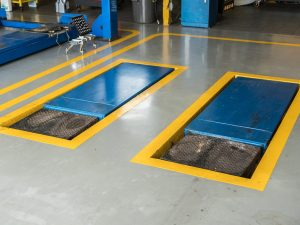 Two hydraulic car lifts built into the floor